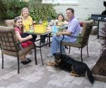 Family entertaining on DIY paver patio.
