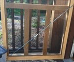 Screen door with turnbuckle installed.