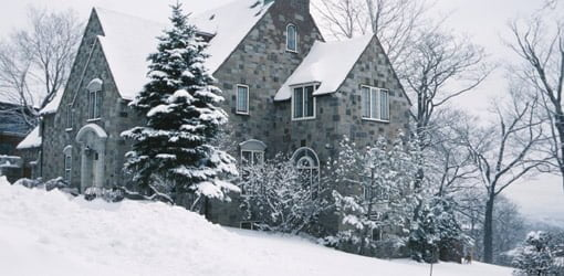 Stone house covered in snow.
