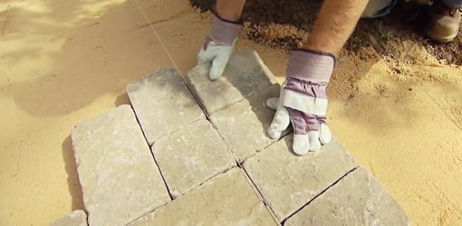 Laying a paver patio.