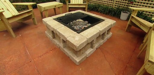 Paver fire pit on concrete patio.