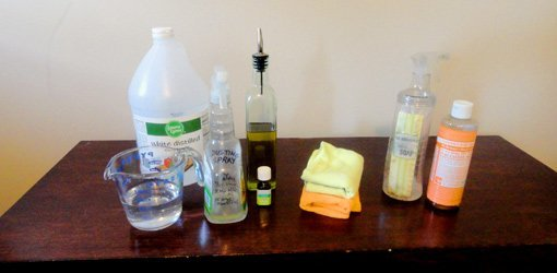 Cleaning supplies on wood table.