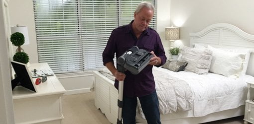 Danny Lipford examining central vacuum cleaner.