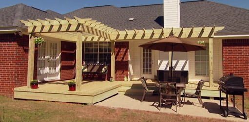 Completed wood pergola shade arbor on back of brick house. - How To Build A Pergola For Your Yard Today's Homeowner