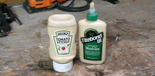 Wood glue in wide top, condiment bottle with bottle of wood glue next to it..