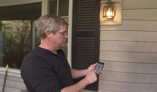 Allen Lyle using smartphone to control porch light.