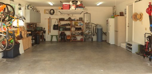 Organized garage with shelves, overhead storage, and wall-mounted bike racks.