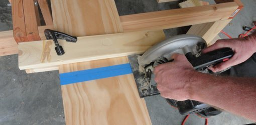 Cutting board with circular saw guided by clamped wood fence.