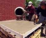 Pouring concrete in the form for a concrete countertop.