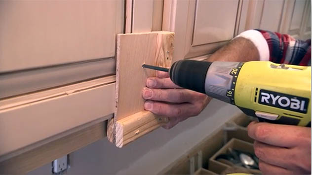 Using a jig ensures consistent placement of cabinet hardware.