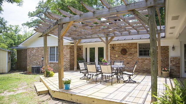 deck with pergola and outdoor furniture