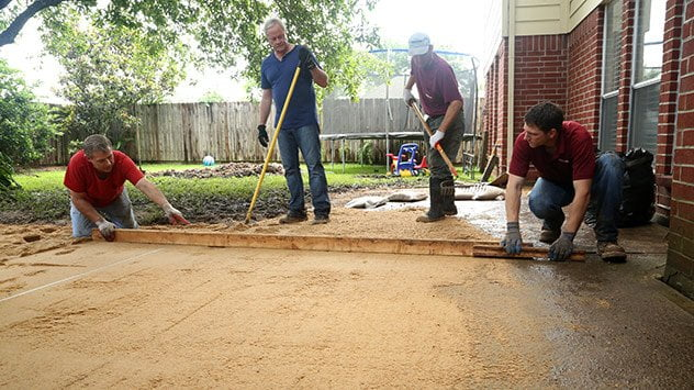 The first step in laying a paver patio is to remove at least 4 inches of dirt before laying the base.