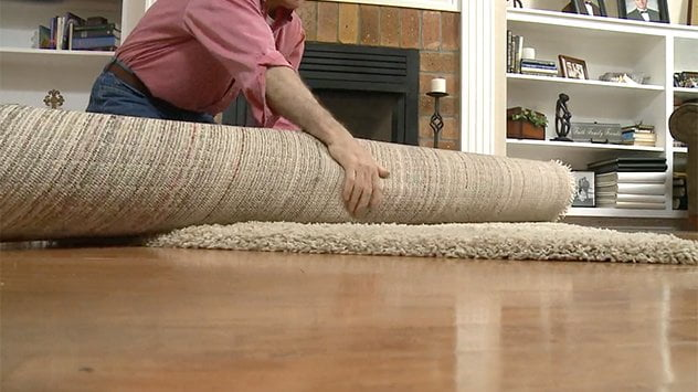 rolling up a rug