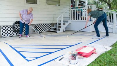 How To Create A Painted Rug On Concrete Today S Homeowner