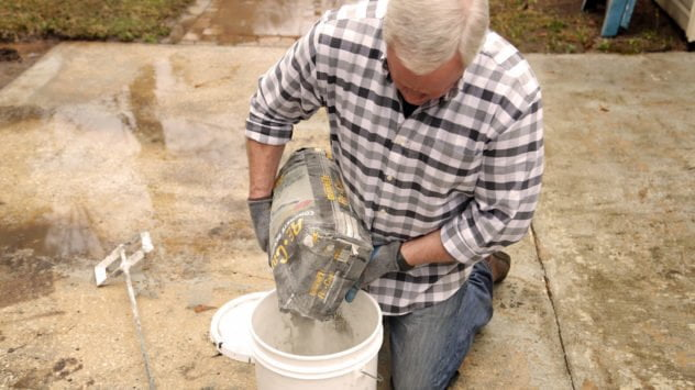 Trowel on Quikrete Re-Cap Concrete Resurfacer to revive your worn patio.