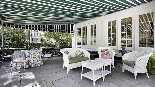 Retractable awning over a patio